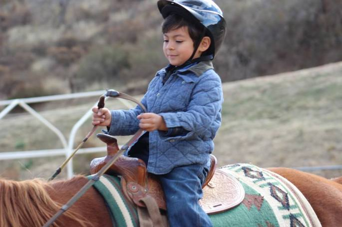 Boy Horseback Riding